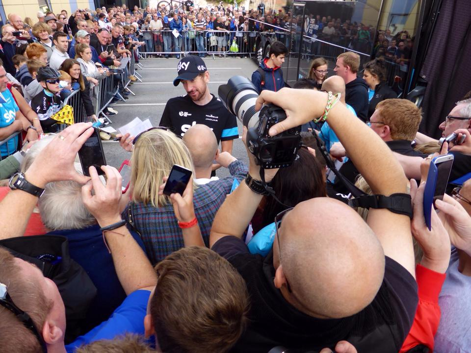 Chief Paparazzi snapper Penny, captures the Wiggo effect - still very much in evidence at the Team Sky bus.