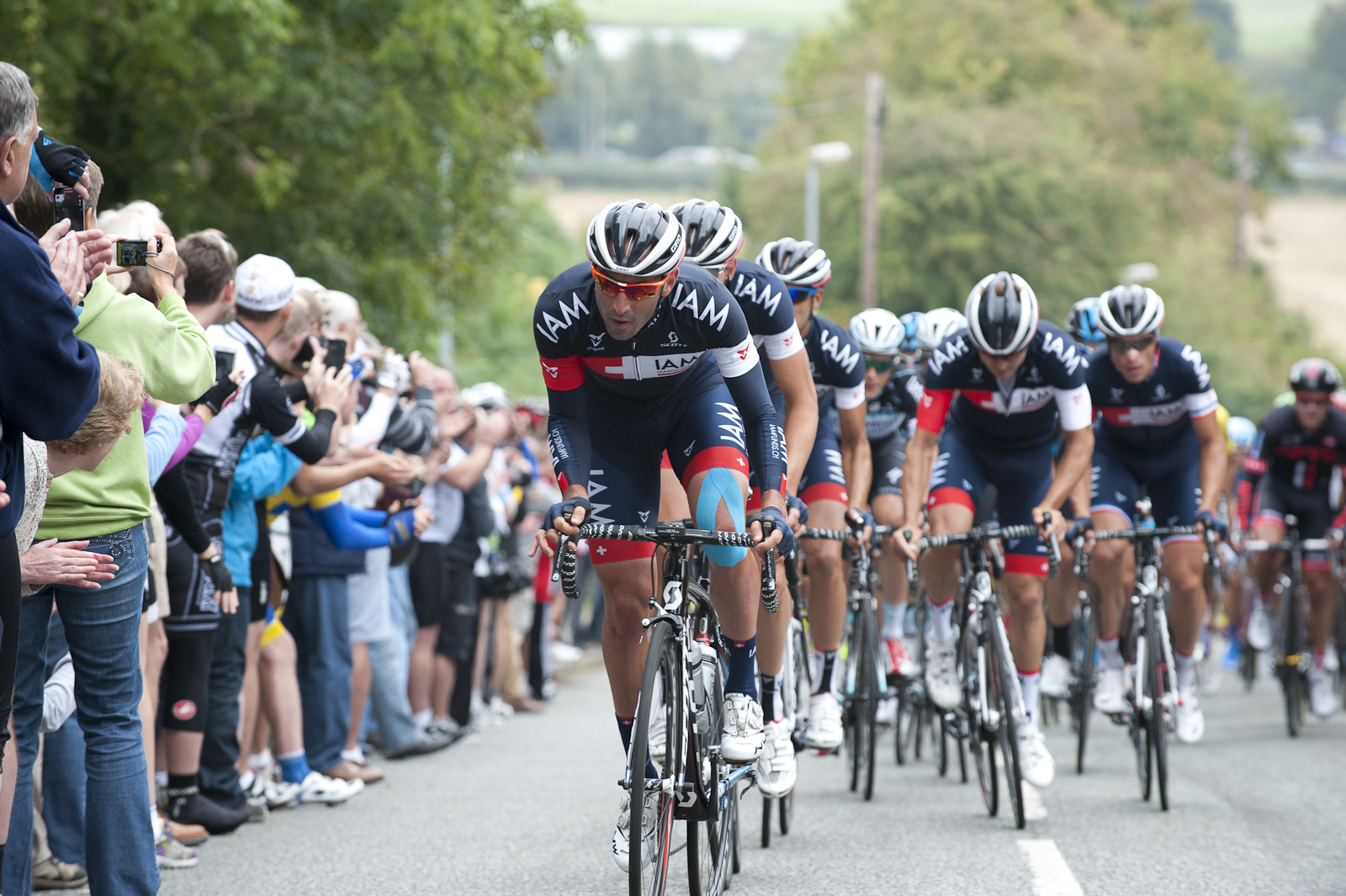 The big boys soon followed with Jerome Pineau leading IAM cycling up the climb.
