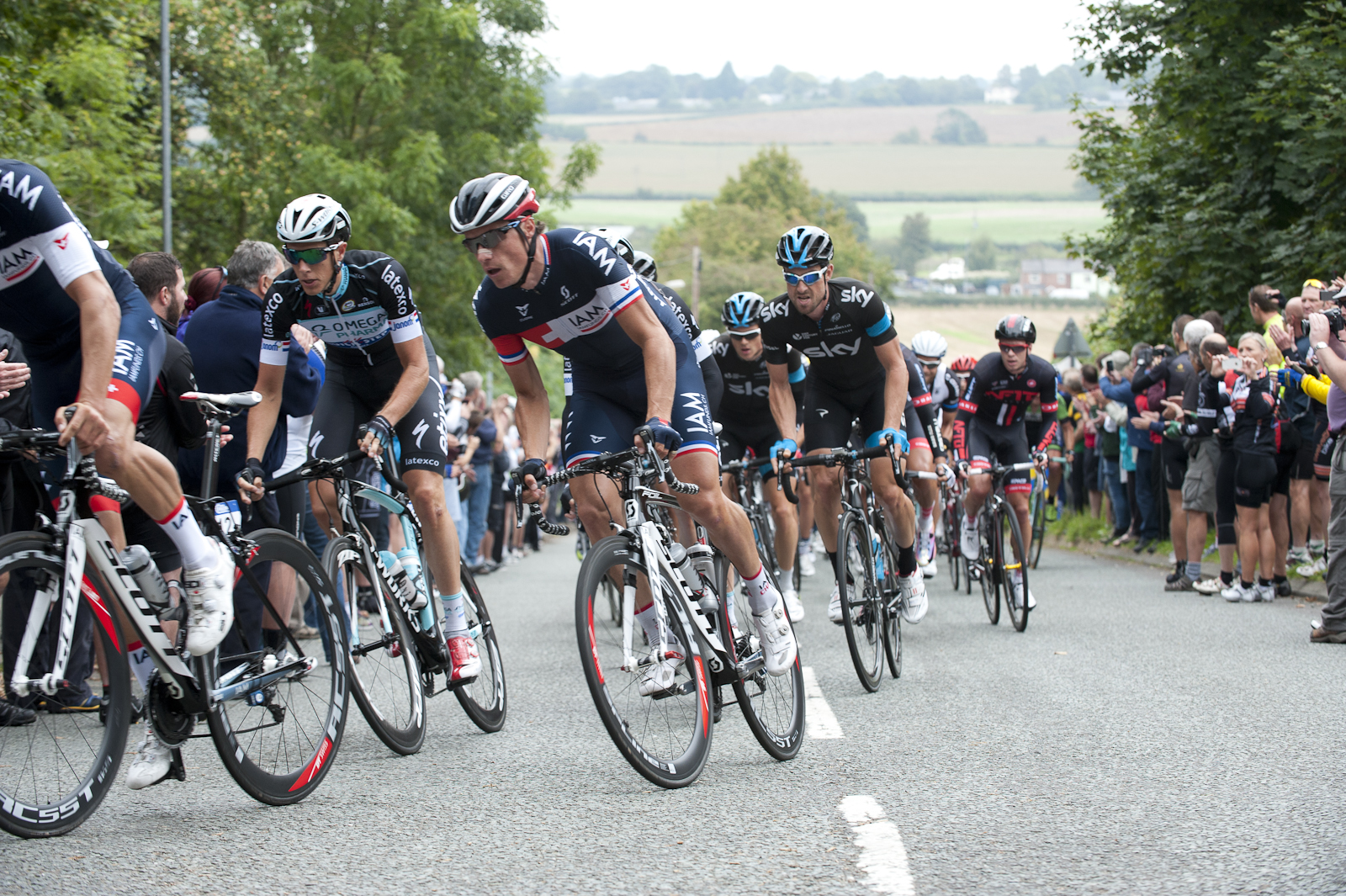 The team towing Sylvain Chavanel up, whilst Bernie Eisel grimaces behind.