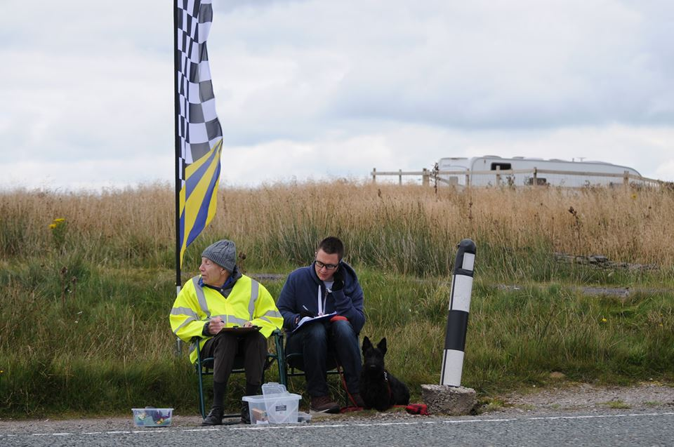Tony, Woody, and Maisie the timekeeping dog, alert the bark out the next number and record the rider's times over the line.